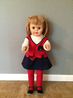 Vintage vinyl 27 inch doll - red, white, and blue outfit