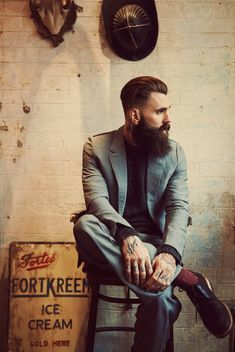 A finely dressed and tattooed gentleman. From the November 2013 issue of L'Officiel Hommes Turkey.