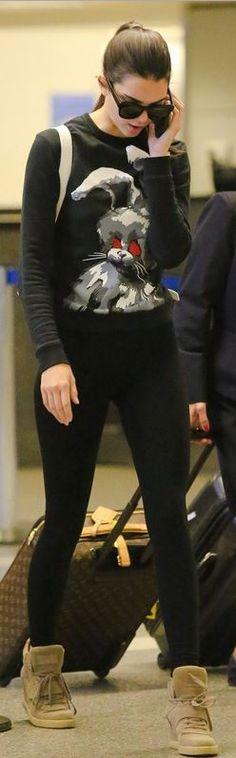 Kendall Jenner:Sweatshirt – Alexander McQueen  Suitcase – Louis Vuitton  Shoes – Ash  Net a Porter