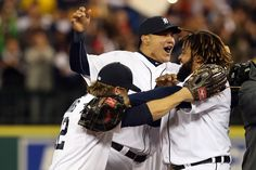 Andy Dirks #12, Avisail Garcia #34 and Prince Fielder #28 of the Detroit Tigers celebrate after they won 8-1 against the New York Yankees during game four of the American League Championship Series at Comerica Park on October 18, 2012 in Detroit, Michigan.
