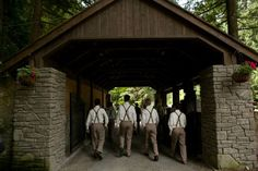 Olde Stone Stables Kaspars Special Events & Catering exclusive Washington venue features a covered bridge, stone waterfall wall, covered bridge, stone turret, draw bridge, hitching post, oversized rustic barn doors, and a lower grassy meadow.