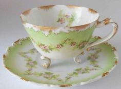 soft green footed tea cup and saucer with floral garlands