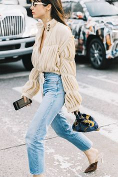 Combining a cool statement top with a pair of pants is the ultimate simple outfit formula. See how fashion girls are wearing it and shop our favorites.