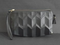 e0244b01645c Stylish leather wristlet for the evening. Feminin rounded rectangular shape.  Special 3D Leather details