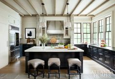 Another great example of having an uninterrupted space for the cook. With lots of counter space on the island, and a compact work zone, this dream kitchen would be easy on the elbows. Source: Atlanta Homes & Lifestyles New Kitchen, Kitchen Dining, Kitchen Cabinets, Kitchen Layout, Funny Kitchen, Kitchen Stools, Kitchen Counters, Black Cabinets, Kitchen Sinks