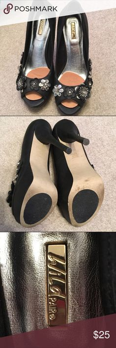 "Wild Pair 5 1/2"" Black Stilettos w/ floral detail Size 9. Anti slip on the bottom of the shoe. Cushion pads for balls of feet. 5 1/2"" stiletto heel. Worn twice. Wild Pair Shoes Heels"