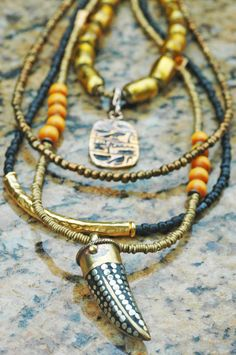 Wild Cat Tusk Necklace: Long Tribal Style Gold, Black, Amber and Bronze Tibetan Tusk Necklace Cat Necklace, Tribal Necklace, Tribal Jewelry, Gems Jewelry, Beaded Jewelry, Handmade Jewelry, Style Ethnique, Tribal Fashion, Women's Fashion