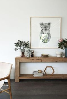 A beautifully chunky Mark Tuckey console table is filled with ceramics by Marmouset Found and Studio Twocan. Above hangs 'The Alchemist' limited edition print by Carla Fletcher. A stack of man Living Room Decor, Living Spaces, Living Rooms, Interior Styling, Interior Design, Timber Furniture, Diy Furniture, Apartment Furniture, Decoration