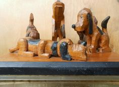 WHIMSICAL SCENE FEATURING 5 HAND CARVED WOODEN  DOGS,  A TRULY UNIQUE CREATION !
