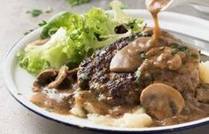 Salisbury Steak with Mushroom Gravy is a comfort food favourite that's quick and easy to make. Make it once and this will be a recipe you'l. Salisbury Steak With Mushroom Gravy Recipe, Salisbury Steak Recipes, Food Network Recipes, Food Processor Recipes, The Kitchen Food Network, Sweets Recipes, Greek Recipes, Kitchen Recipes, Tasty Dishes