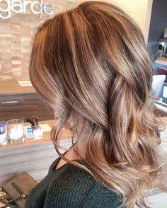 Alicia's client came in with her natural solid brown hair and wanted to lighten it up. So naturally we balyaged! ~ Avant Garde Salon Spa