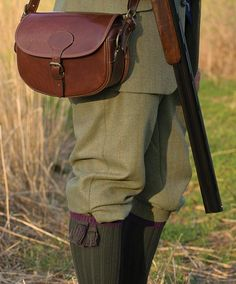 Manor Tweed breeks complement the Manor Tweed vest, jacket and coat. Lined with CTX membrane providing comfort regardless of the weather conditions and is silent for use in stalking. Trimmed front pockets and one rear button-through flap pocket. Adjustable strap at the cuffs and anti-slip tape on the inside of the waistband and cuffs. Leather buttons. Shooting breeks in Manor Tweed olive. Wool with polyester lining. Dry clean. Imported. <br />Even waist sizes: 32, 34, 38, 42.