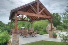 Equipped with a built-in grill, the covered outdoor living space offers a beautiful place to enjoy a summer bar-b-ques.