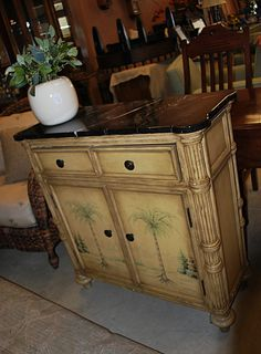 Palm trees decorate this lovely stand, perfect for storing linens and china. find it at www.whisperingwillowprimitives.com