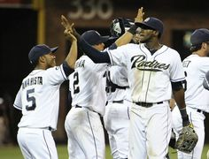 Game #113 8/7/12: Cameron Maybin #24 of the San Diego Padres, right, high-fives Alexi Amarista #5 after beating the Chicago Cubs in a baseball game at Petco Park on August 7, 2012 in San Diego, California. (Photo by Denis Poroy/Getty Images)