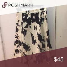 Zara skirt size S Zara skirt white with black flowers. It's A line, below knee. This skirt was shown in the tv series devious maids worn by Evelyn powers. It's very nice and it was worn only twice Zara Skirts A-Line or Full