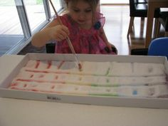 Why would you need crayons, paint, or pencils and paper to draw when you can have more fun with a Rainbow Salt Tray!  Draw pictures, create patterns and practice writing your name with this simple to make Rainbow Salt Tray.  The greatest thing about a Rainbow Salt Tray is that it is cheap to set up, educational, and it will entertain your small ones for hours!