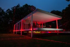 The Farnsworth House illuminated by latticed red lasers that extend out into the homes natural surroundings. #dwell #contemporaryhomedesignnews #designnews #ludwigmiesvanderrohe