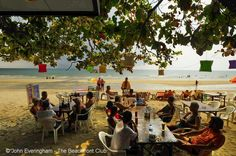 Koh Chang, Thailand. Sai Khao Beach's restaurants and bars remain open all day in the shade of big trees.