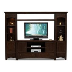 On A Mission. Classic and elegant, the mission-inspired style of the Arts and Crafts entertainment center brings a timeless charm to your living space. This wooden set is solidly constructed and features crown molding accents, veneers in a rich chocolate shade, a slatted design motif, exposed mortise and tenon details and hammered pewter hardware. Adjustable shelves and plentiful cabinets and drawers provide flexible space for all your family's home entertainment needs. Four-piece package…