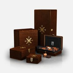 zChocolat: Opulent collection of handmade gift boxes is constructed from radiant mahogany. Chocolates are produced in Aix-en-Provence, France by award winning chocolatier Pascal Caffet.