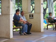 """In front of the VA clinic at Tripler.  Notice the cigarette sucker next to the """"No smoking"""" sign."""