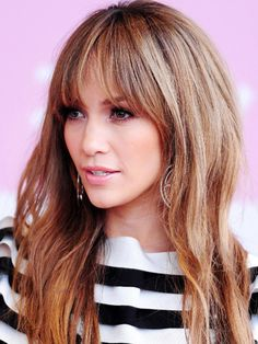 LOVE bangs and color....I've read several times that she colors her hair every 14 days b/c of greys......