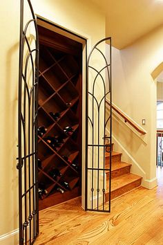 Adjacent To The Family Room, Dining Room And Staircase To The Third Floor  Is Nestled The Wine Cellar. Wrought Iron Doors Add Character To This  Functional ...
