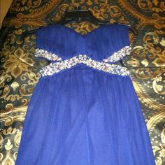 Long strapless prom dress Only worn once, new condition, size 3 (juniors) I'm 18 and the juniors sizes seem to fit me fine so I would say the juniors and adult sizes in this case are pretty much the same. Trixxi Dresses Strapless