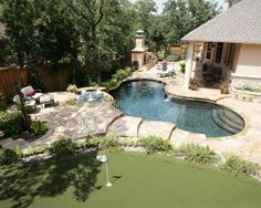 Your own private country club, complete with pool, spa, and putting green! #swimmingpool #landscaping