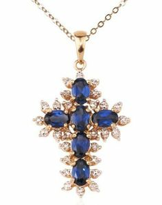 Gold Over Sterling Silver and Blue Cubic Zirconia Cross Pendant Joolwe. $79.99. Save 55%!
