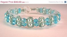 ON SALE Unique Woven Aqua Crystal, Pearl and Seed Bead Bracelet with a Toggle Clasp