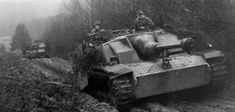 German troops drive a Sturmgeschütz tank- Germany's most-produced armoured fighting vehicle during World War II - down a dirt track in Ardennes, Belgium, during the Battle of the Bulge in 1944 Ww2 Panzer, Luftwaffe, Willys Mb, Tank Armor, Germany Ww2, Ww2 Photos, Ww2 Pictures, Tiger Tank, Dioramas