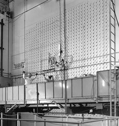 X-10 graphite reactor. Oak Ridge Tennessee. Workers loading Uranium slugs into the reactor.