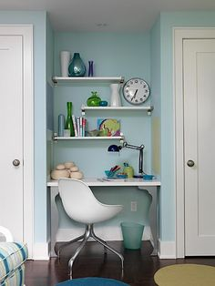 Small Home Office Design Ideas. Wall mounted shelves tucked in an unused space created this great office space.