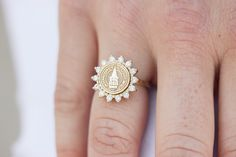 This style features a round seal with a halo of fourteen brilliant cut stones. This style can be paired with any of our bands. San Jose Jewelers, Custom Class Rings, College Rings, Halo, Pairs, Engagement Rings, Stone, Accessories, Graduation