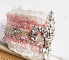 fabric cuff bracelets: hand and machine stitched with vintage lace, ribbon and vintage re-purposed jewelry