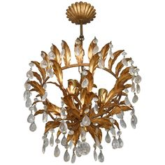 Hollywood Regency or Florentine Style Chandelier Gold with Crystals, Italy, 1950 | From a unique collection of antique and modern chandeliers and pendants at https://www.1stdibs.com/furniture/lighting/chandeliers-pendant-lights/