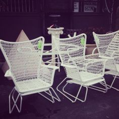 vintage outdoor lounge chairs with pull out foot stools.