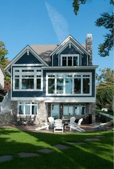 The exterior sets the tone for the coastal style that features durable fiber cement siding that will withstand the lakeshore elements, painted a unique shade of nautical blue with contrasting white trim. Michigan's own Black River Ashlar and a standing seam roof done in champagne metallic further accentuate this waterfront home.