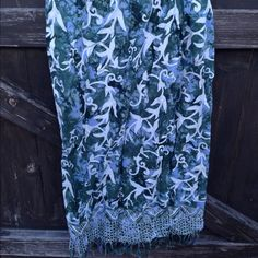 Vintage Wrap Skirt. Batik. Pier One Imports Vintage, From the original Pier One Imports, Sam Francisco, this wrap skirt is in incredible tie dyed/batik fabric in an unusual color combination: sky-blue, palm green and white. Fringed bottom, coconut buttons, elastic waist in the back, a true wrap/sarong style.  Their early line was called Passports. Large. Fits 10-12. Vintage Skirts