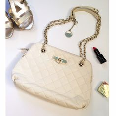 ✨Host Pick✨ DKNY Cream Quilted Purse Beautiful leather bag! Gold hardware. The straps can be worn double handled (13in drop) or one long strap(24in drop). Great condition! The leather does have some natural cracking as any soft leather bag will get over time (shown in pictures). Inside is in perfect condition. Used only a few times then stored. Still available at Bloomingdales for $198. More pictures available upon request. 13x9x2. Comes with dust bag! Host Pick Polished and Preppy Party…