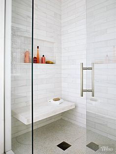 """The back-and-forth tension between traditional and contemporary comes into play in the shower, too, where traditional subway tiles were ramped up in length. """"It's more contemporary,"""" Soucie says. """"I like the bigger size with the least amount of grout, which makes it more about the tile."""" A floating bench adds convenience and a layer of luxury."""