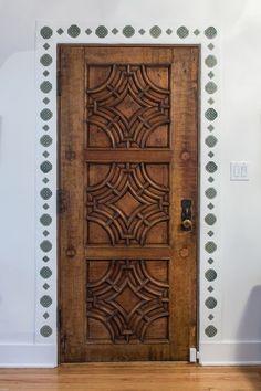 Mediterranean decor | carved wood door | interior design ideas