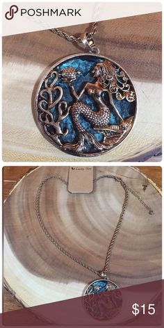 Antiqued Gold Mermaid Pendant Large medallion pendant in antiqued gold finish. Jewelry Necklaces