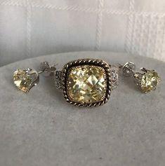 Lia Sophia peach tone crystal with gold toned braided band