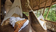 The Master Bedroom air-conditioned bed and bamboo hammock at Peter's house in Green Village by Ibuku, bamboo design and architecture in Bali Feng Shui, Bamboo Village, Hanging Hammock Chair, Hanging Chairs, Bamboo Structure, Bamboo Architecture, Bamboo House, Tropical Decor, Home Interior Design