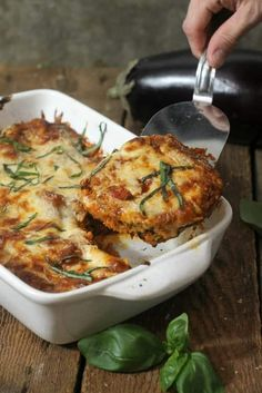 A vegetarian dish even the meat-eaters can enjoy this baked eggplant parmesan is loaded with crispy breaded eggplant slices a rich tomato garlic and herb sauce then topped with shredded mozzarella and Parmesan. Gourmet Recipes, Vegetarian Recipes, Cooking Recipes, Healthy Recipes, Healthy Eggplant Recipes, Vegetarian Cookbook, Cheap Recipes, Healthy Dishes, Breakfast