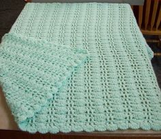 Baby blanket I crocheted with Lion Brand pound of love yarn.