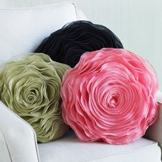 """A rose by another name is a pillow? Of course. Style your space with blooms of color in twirling layers of chiffon. Polyester. Dry clean. Imported. 16"""" dia."""